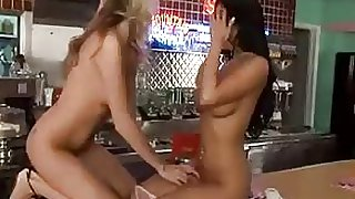 Sexy hot lesbian babes are in a retro kitchen and have some amazing waitress sex on the counter...