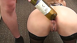 Gaping my wife's loose rectal hole with a bottle in advance of having sex