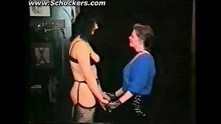 Vintage movie of mistress who ties slave to a table and plays with her pussy and nipples bdsm